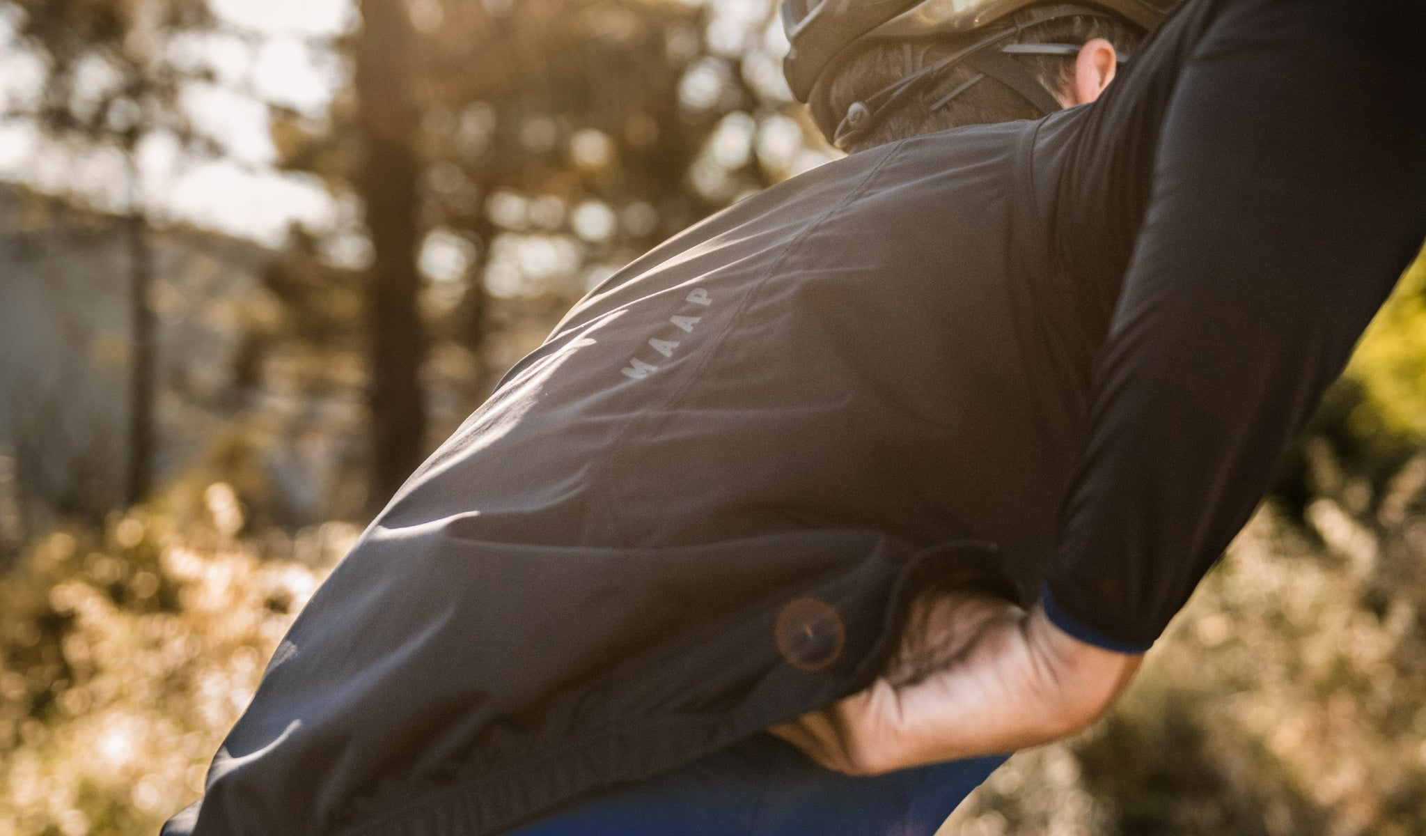 MAAP Unite Team Rain Cycling Jacket in Black for riding in wet weather conditions.