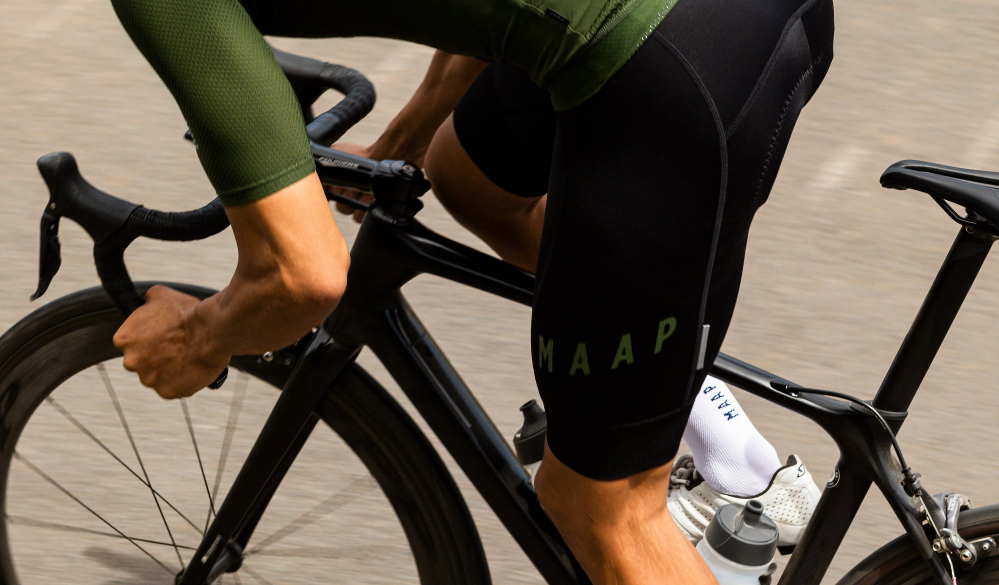 MAAP Team Cycling Bib Shorts in Black/Military Green for riding in warm weather conditions.