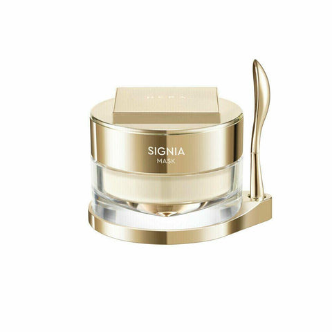 HERA Signia Mask (80ml)  Features Hydrates and calms skin and keeps skins moisture  during sleep so you can experience moist and smooth skin next morning.  5-times concentrated micro algae ingredients activate moisture on skin.  Water-splash formula that turns into drops when it touches skin,  stabilized ingredients using lipid pink capsule keep skin moist for a long time.  How to use At the last step of skin cate at night,  release an appropriate amount and apply evenly.  Wash next morning or after 10~20 minutes.  Specification  Brand : HERA  Country of origin : Republic of Korea  Target Area : Face - Skin Type : All Skin Types  Condition : 100% Brand-new with original box  Capacity: 80ml