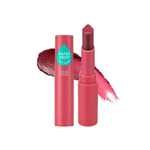 Holika Holika  Water Drop Tint Bomb 09 Rose Water  Features The lipstick makes the lips look attractive with 40% water texture  and favorite color. Apply on the entire lips along the lip line  or on the center of the lips in a tapping motion to express gradation.  How to use Apply an adequate amount on the lip depending on the look you want.  Specification Brand : Holika Holika  Country of origin : Republic of Korea  Target Area : Lip - Skin Type : All Skin Types  Condition : 100% Brand-new with original box  Capacity: 2.5g