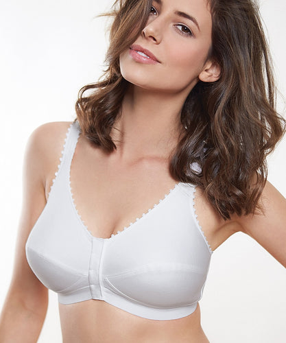 image of model in white front fastening soft cup bra