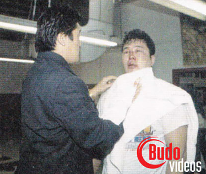 Yoji Anjo getting blood wiped off his face