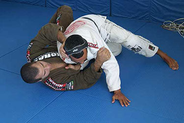 Kid Peligro on the mats