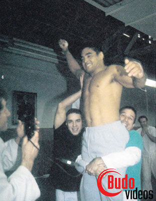 Rickson Gracie being hoisted after his victory