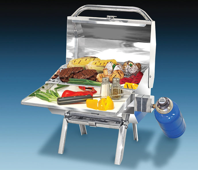 Trailmate Rectangular grill with grilled steak and vegetables on table legs