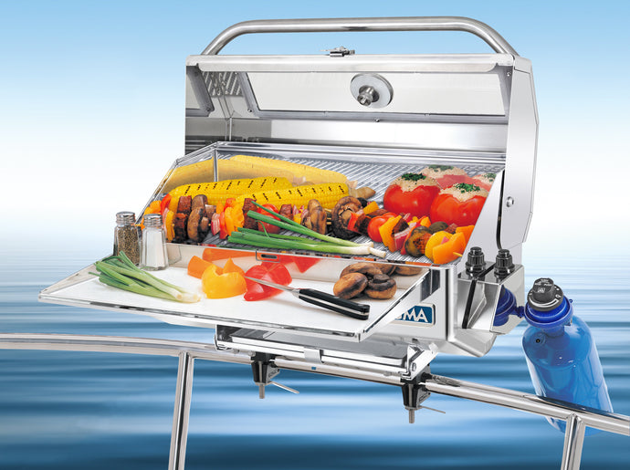 Newport Infrared Rectangular grill mounted on boat with grilled skewers and vegetables