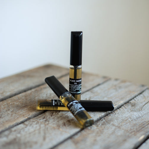 black castor oil serum for eyelashes lashes brows mascara tube by suneeta London x weigh and pay