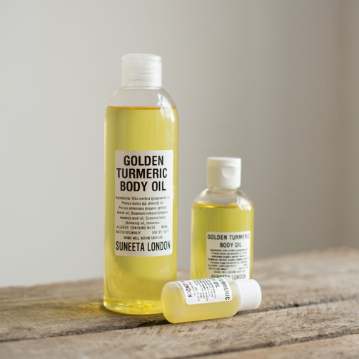 golden turmeric body oil in various sizes, by Suneeta London x weigh and pay