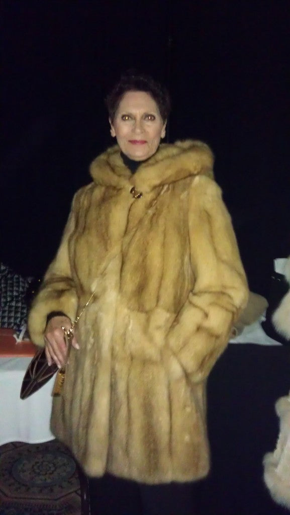 Image of a woman wearing a fur coat at the St.Demetrios Philoptochos and Alderman Patrick O'Connor event