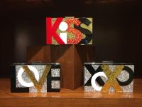 From the York Furrier 86th Anniversary Accessory Collection, the LOVE, KiSS, and XoXo Message Box Clutches.