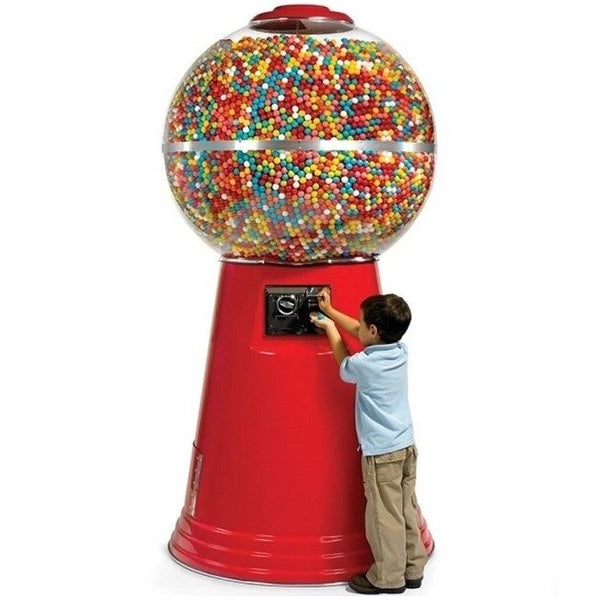 Kid buying a gumball from a red colored Jumbo Giant gumball machine