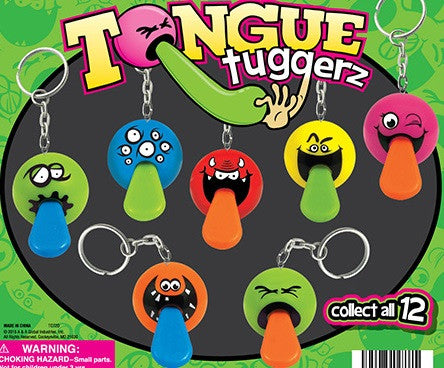 Tongue Tuggerz keychains 2 inch capsules front of display