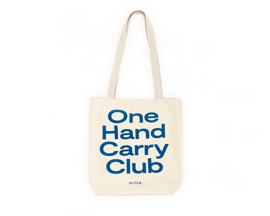 Canvas Tote with shoulder strap, text says One Hand Carry Club