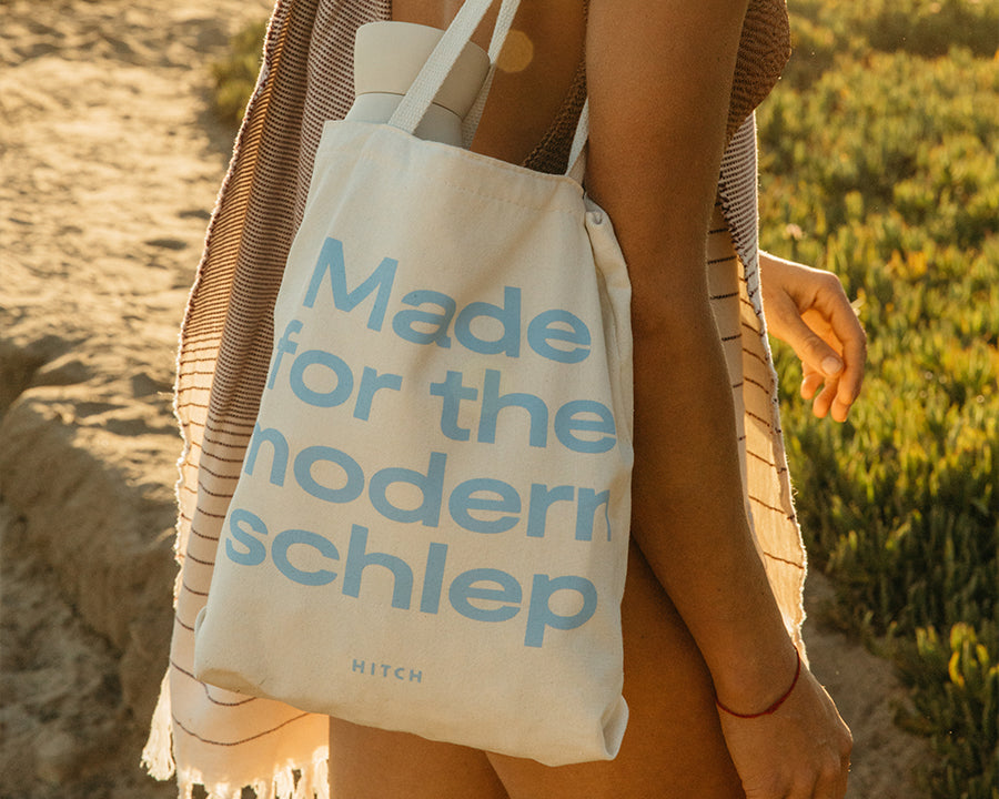 Women carrying canvas Hitch Tote with Made for the modern schlep printed in light blue, made in america