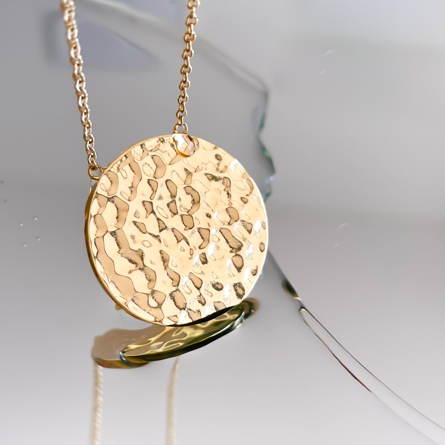 Gold hammer disc necklace