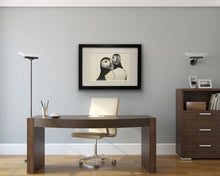 Load image into Gallery viewer, framed hand drawn image of 2 puffins hung on wall behind desk in study