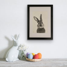 Load image into Gallery viewer, image of hand drawn bunny rabbit drawing framed and hung next to bunny ornament and eggs
