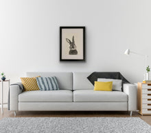 Load image into Gallery viewer, hand drawn framed image of bunny hung on wall above sofa