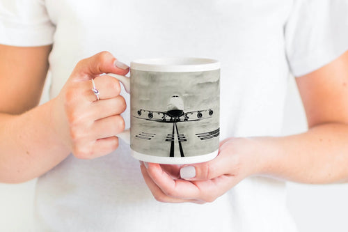 fine bone china mug featuring 747 plane artwork on in balmoral style, being held in someones hands