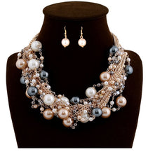 Load image into Gallery viewer, Fashion women's exaggerated mixed color pearl necklace short earrings necklace set