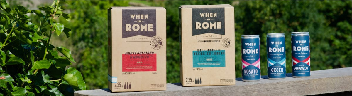 Italian box wine and canned wine in countryside surroundings