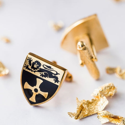 Close up of Newcastle University gold plated cuff links