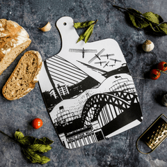 Melamine chopping board with black and white design featuring landmarks from Newcastle & Gateshead