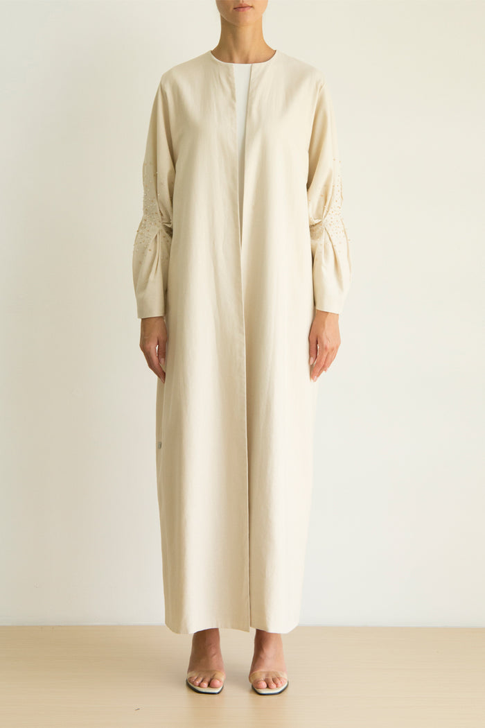 Beige linen Abaya with lantern pleat sleeves and scatter crystal embroidery detail