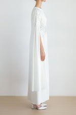 Star dust embellished dress with slit and cape sleeves details