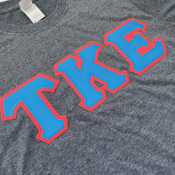 Tau Kappa Epsilon Stitched Letter T-Shirt | Dark Heather | Cyan with Pink Border