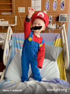 four year old Henry, battling leukemia, being cheered up by Starlight