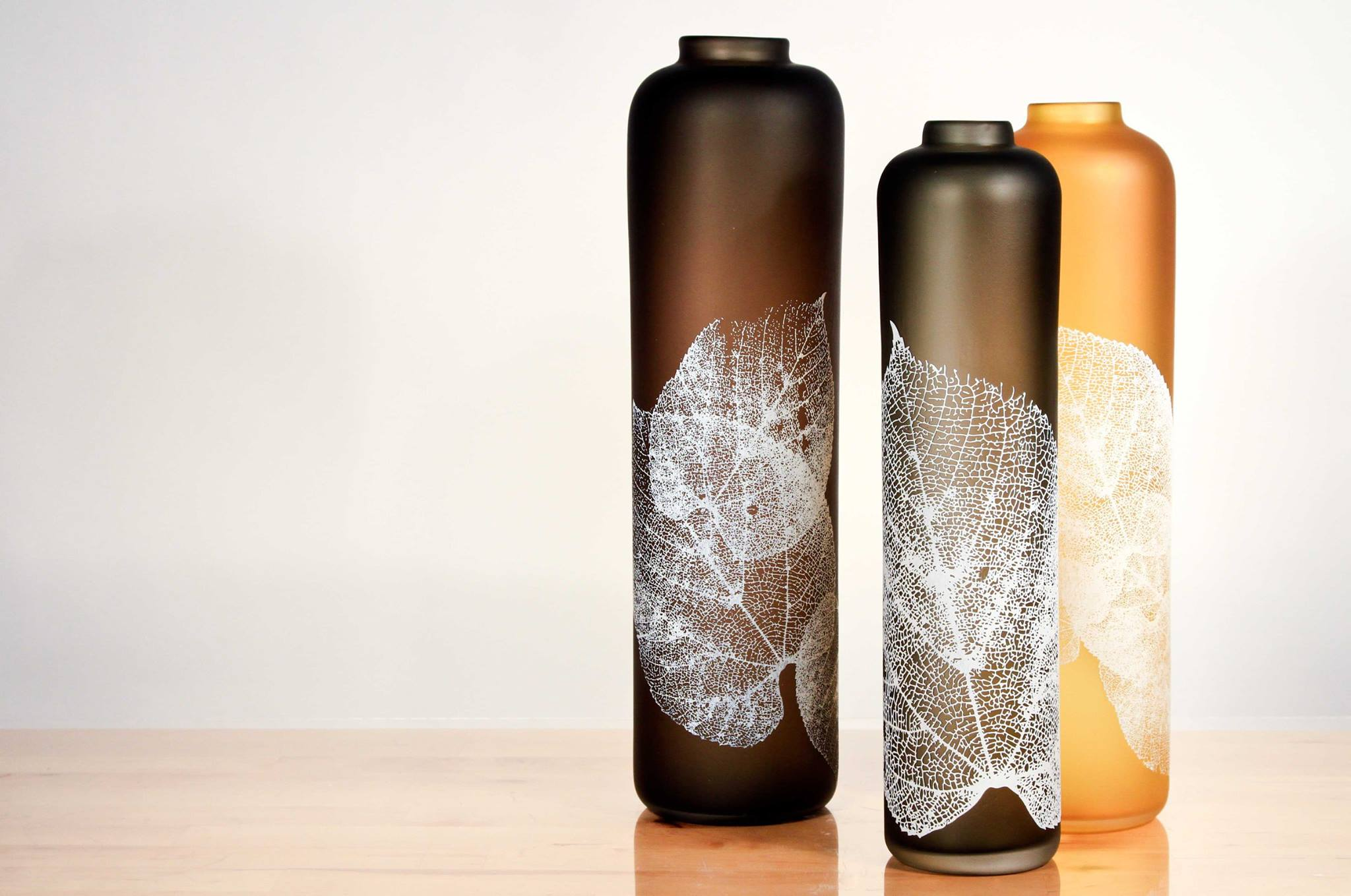 Glass vessels with sandblasted leaf detail by Nick Chase