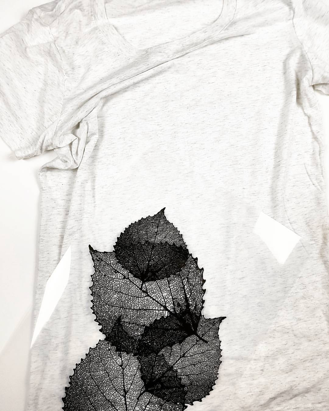 Women's shirt with transparency of leaves against it