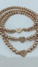 Load and play video in Gallery viewer, Initial Heart Bracelet- Gold Beads