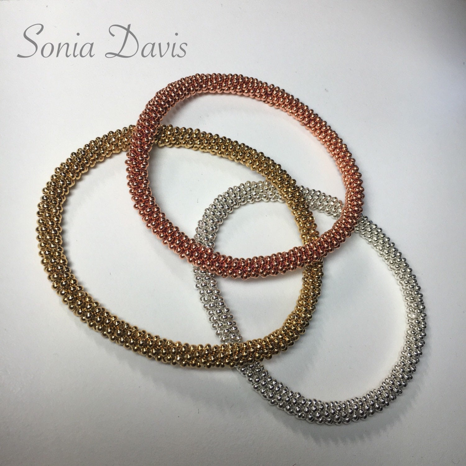 "A ""Truly Seamless"" Beaded Kumihimo Bangle, using Size 11 seed beads, FB Demo....https://www.facebook.com/groups/1875365316078793/"
