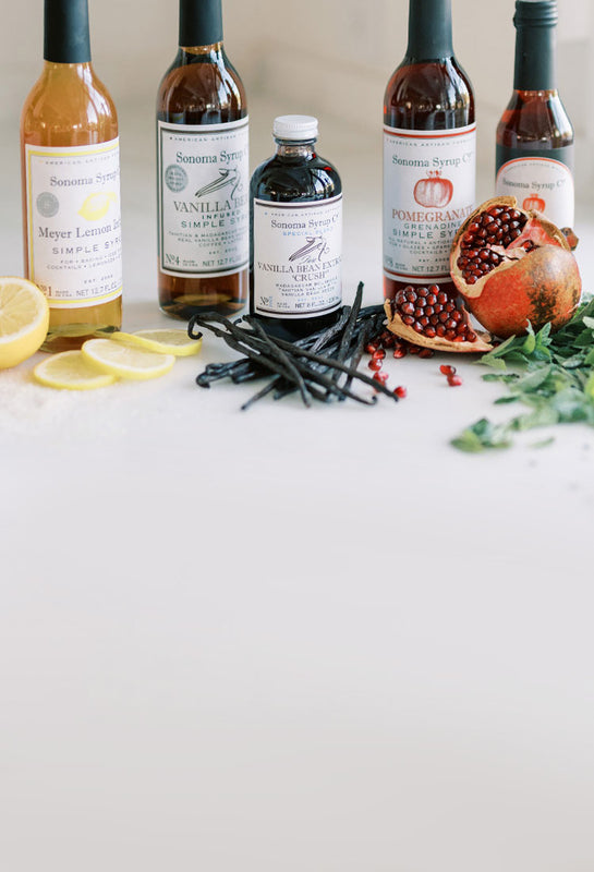 Array of Sonoma Syrup products and natural botanicals, citrus and vanilla beans