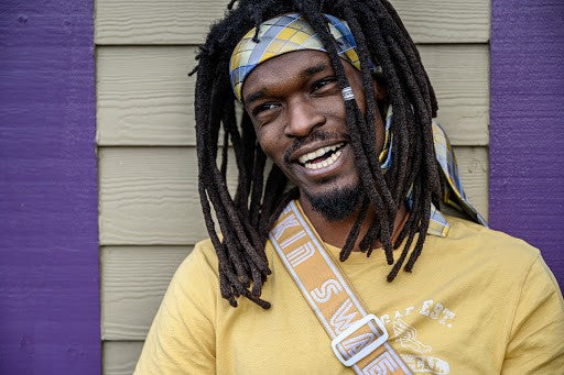 Smiling Man With Locs
