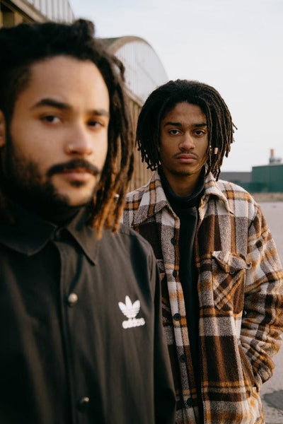 Two young men with dreadlocks
