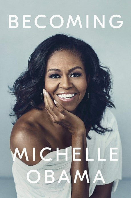 """""""Becoming"""" book cover with Michelle Obama posing on the front"""