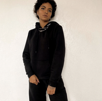Influencer wearing our jet black ukiyo hoodie, coupled with chain necklaces