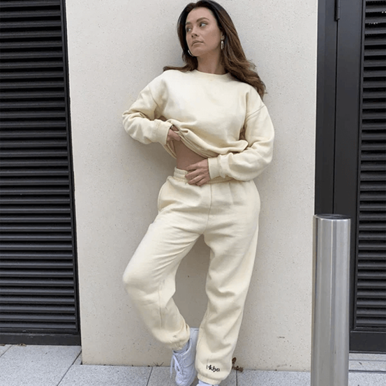Image of an influencer outside a building wearing our Ukiyo French Vanilla Sweatshirt Tracksuit Set