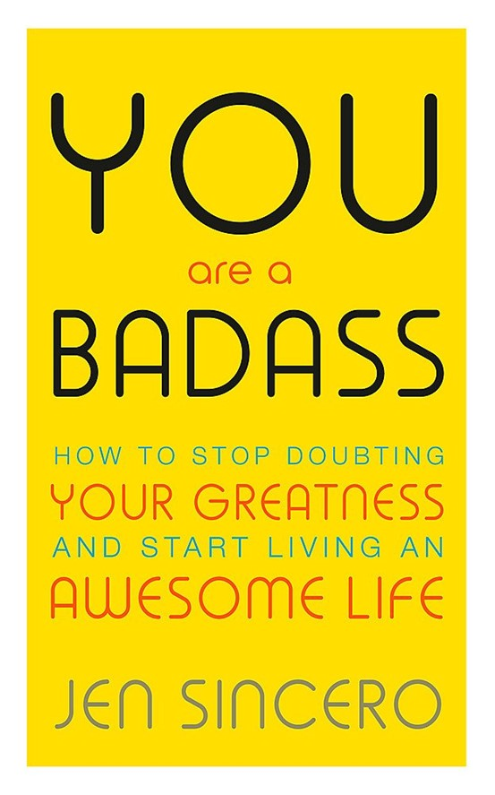 """""""You Are a Badass: How to Stop Doubting Your Greatness and Start Living an Awesome Life"""" yellow book cover with bold black writing"""