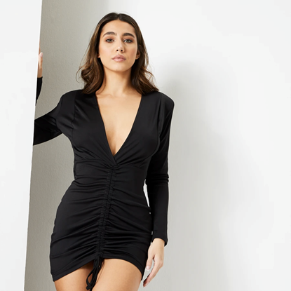 Female model with brown hair standing wearing Jet Black Satin Ruched Front Ukiyo Mini Dress