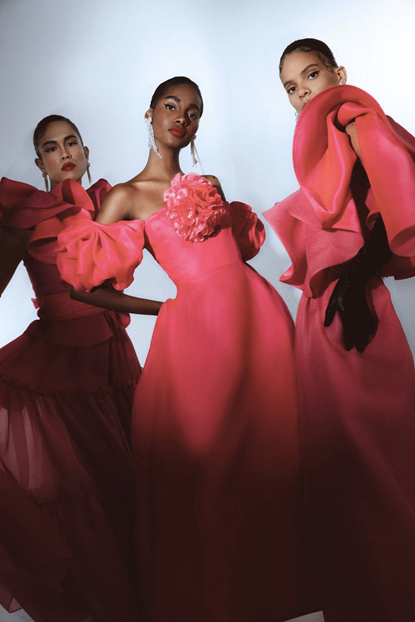 Prabal Gurung's fashion outfit photograph of three models in pink dresses, with ruffled fronts and short-sleeves