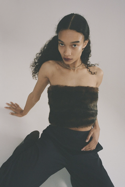 Sandy Liang's outfit photograph of model in black pants and a fur tube top