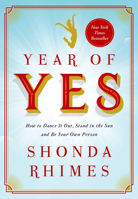 """""""Year of Yes: How to Dance It Out, Stand In the Sun and Be Your Own Person"""" book cover with red and yellow font and a woman jumping on the cover"""