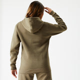Female model with brown hair standing wearing Frosted Olive Ukiyo Hoodie and Frosted Olive Ukiyo Ultimate Joggers