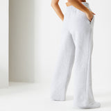 Female model standing wearing Ice Grey Pin Tuck Wide Leg Ukiyo Joggers