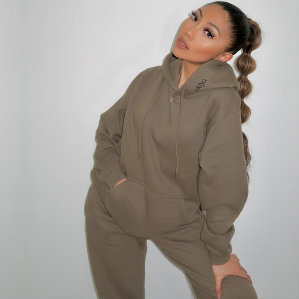 Female model with brown hair standing wearing Frosted Olive Ukiyo Jogger Set
