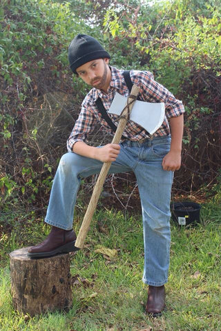 lumberjack Halloween costume with axe made from cardboard mailing tubes